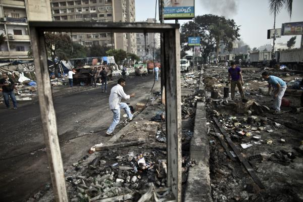 Egyptians search through the debris at Rabaa al-Adawiya square.