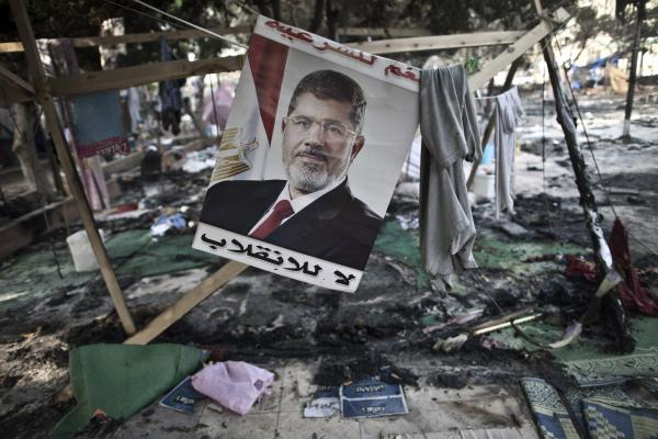 A picture of Morsi is seen hanging amid debris at Rabaa al-Adawiya square.