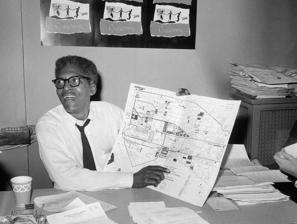 Activist Bayard Rustin points to a map during a press conference four days ahead of the March on Washington in August 1963.