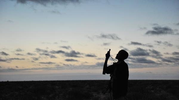 A new project announced by Facebook seeks to make it more affordable to access the Internet via cellphones around the world. In Africa, 16 percent of the population currently uses the Internet. Here, a man looks for a network signal in Somalia.