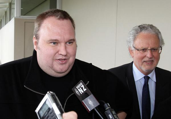 Megaupload boss Kim Dotcom, left, leaves court after he was granted bail in the in Auckland, New Zealand.