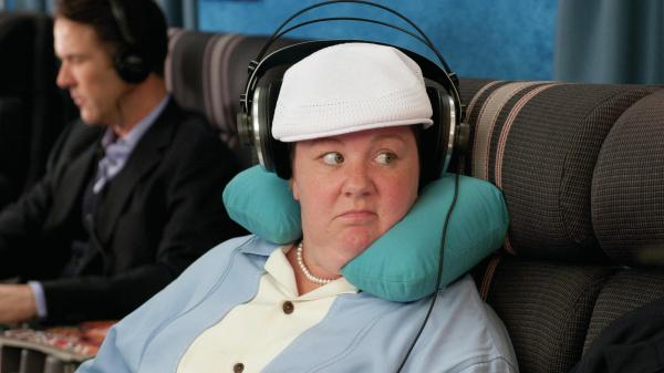 As Melissa McCarthy's etiquette-minded character in <em>Bridesmaids</em> demonstrates, there's nothing wrong with wearing headphones on an airplane.