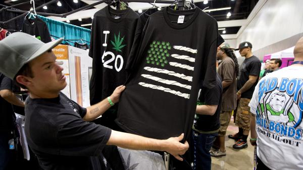 Sen. Patrick Leahy is calling on the Justice Department to state its position on marijuana's legal status. Here, a man inspects a shirt depicting the U.S. flag made of marijuana symbols, at a medical marijuana show in Los Angeles earlier this year.