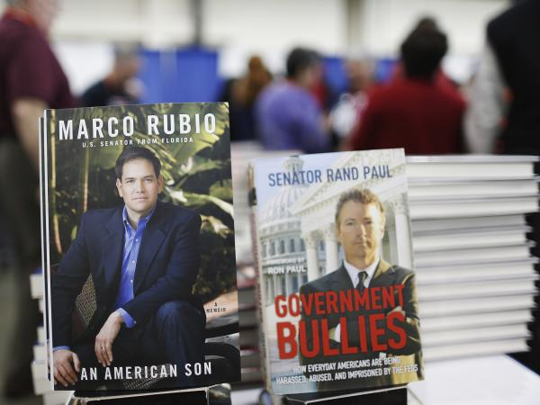 Books by would-be 2016 presidential candidates, Sen. Marco Rubio, R-Fla., and Sen. Rand Paul, R-Ky., share a table display at the Conservative Political Action Conference in National Harbor, Md., on March 15. Both Rubio and Paul on Wednesday voted against military action in Syria.