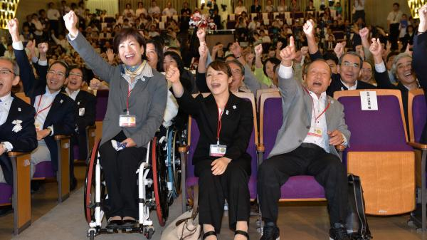 Tokyo will host the 2020 Summer Games, IOC officials said Saturday. In Tokyo, five-time Paralympian Wakako Tsuchida, left, and former Olympic athletes Hiromi Miyake, center, and Yoshiyuki Miyake cheer the news.