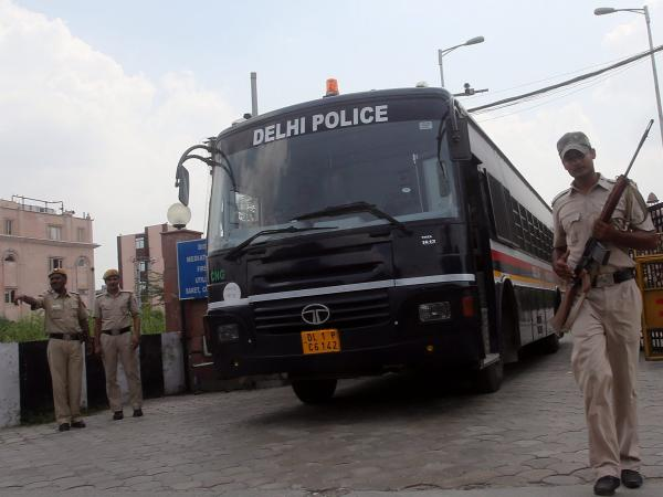 A police bus believed to be carrying the four men convicted for the December rape and murder.
