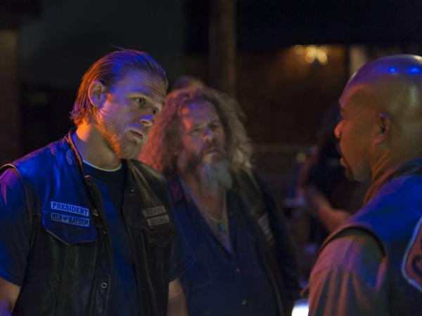 Charlie Hunnam (left) with Mark Boone Jr. and Michael Beach, in an episode of <em>Sons of Anarchy. </em>Don't you just feel a cuss coming on?