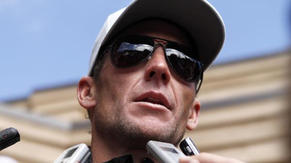 Lance Armstrong talks to the media after the 2011 Xterra Nationals triathlon in Utah.