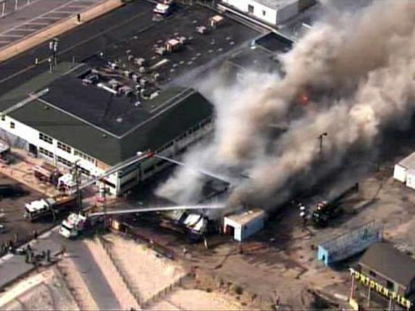 Firefighters battle a raging fire on boardwalk in Seaside Park, N.J., on Thursday.