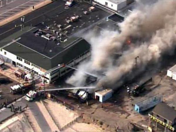 Firefighters battle a raging fire on boardwalk in Seaside Park, N.J., on Thursday.