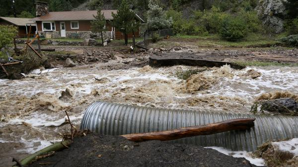 This home was stranded Thursday after a flash flood in Coal Creek destroyed a bridge near Golden, Colo.