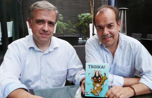 Carlos Mesquita (left) and Filipe Preto invented Vem aí a Troika (Here Comes the Troika), a satirical card game that pokes fun at Portugal's economic crisis and its creditors.