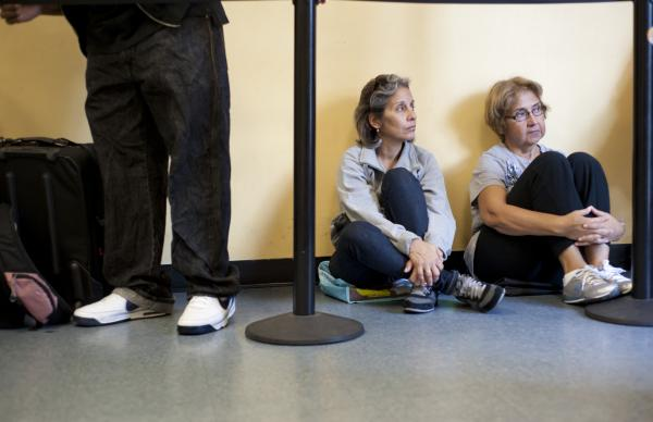 Raisa Ruiz (right) and her niece Mary Badels wait in line at the Manna Food Center, Gaithersburg, Md., on Sept. 13.