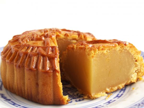 Don't let this close-up confuse you; mooncakes are actually the size and heft of a hockey puck.