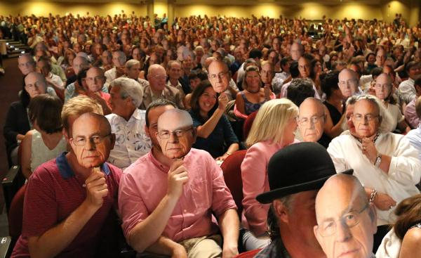 The audience at <em>Wait Wait... Don't Tell Me!</em> in Portland, Maine, holding up faces of Carl Kasell.