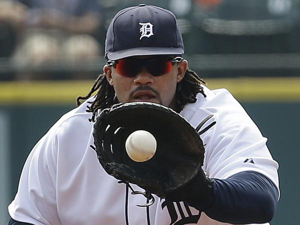 Detroit Tigers first baseman Prince Fielder, who enjoys a snack during a game.