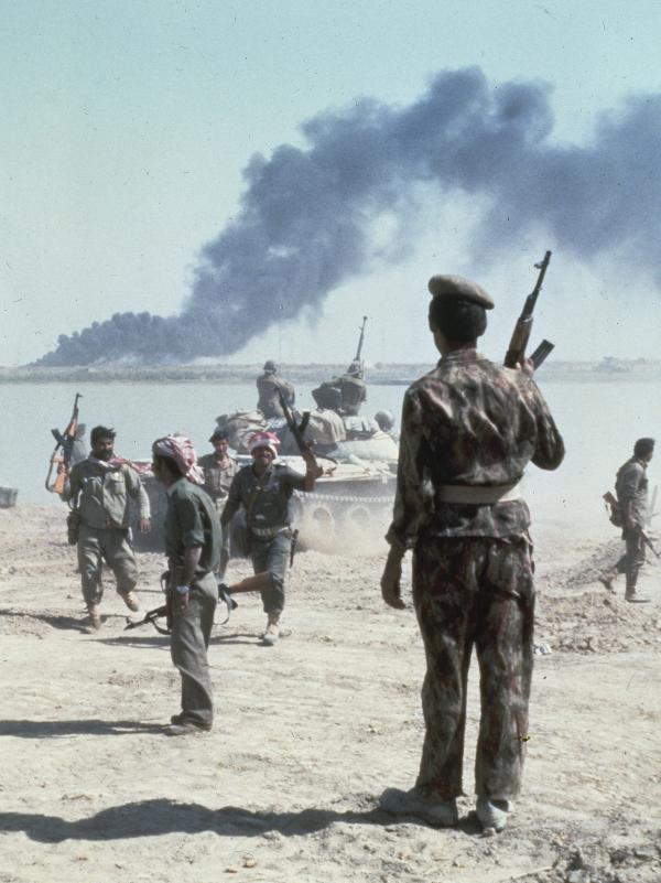 Iraqi troops celebrate a success in October 1980, during the Iran-Iraq War, which still looms large in Iranian memory.