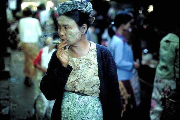 Woman smoking cheroot, Mandalay