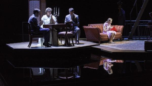 Zachary Quinto (left), Cherry Jones, Brian J. Smith and Celia Keenan-Bolger in <em>The Glass Menagerie</em>, which leaves out some of the elements — such as walls — you might expect in its St. Louis apartment set. The suggestive minimalism of the design is in keeping with the approach Tennessee Williams called for in his extensive stage directions.