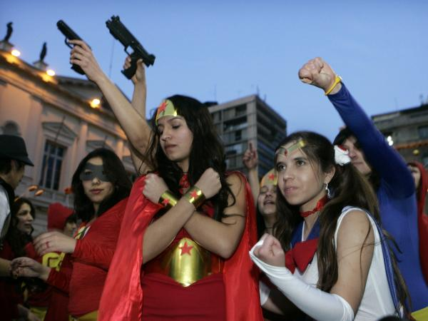 Costumed students protest against the government in Santiago, Chile, in July.