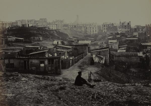 Marville made more than 425 photographs of the narrow streets and crumbling buildings of premodern Paris, including this view from the top of Rue Champlain in 1877-1878.