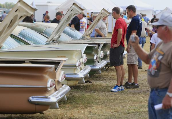 The trunks of Chevrolet sedans are open for Friday's preview before an auction of vintage cars and trucks from the former Lambrecht Chevrolet dealership.
