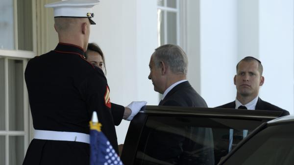 Israeli Prime Minister Benjamin Netanyahu arrives Monday at the White House to meet with President Obama. The two are expected to discuss Iran's nuclear program, Syria's civil war, and peace negotiations with the Palestinians.