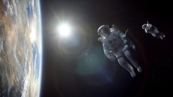 George Clooney and Sandra Bullock play astronauts marooned in space in <em>Gravity,</em> a visual marvel of a movie from director Alfonso Cuaron<em>. </em>