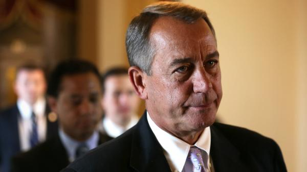 Speaker of the House John Boehner, R-Ohio, makes his way to the House chamber for a procedural vote on Saturday.