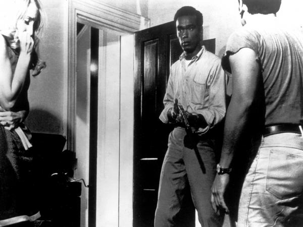 Duane Jones (second from right) makes zombie history as Ben in <em>Night of the Living Dead</em>.