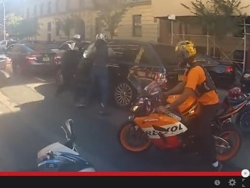 The moment of the attack on Sunday, after dozens of motorcyclists chased and surrounded an SUV. They then smashed its windows and beat the driver.
