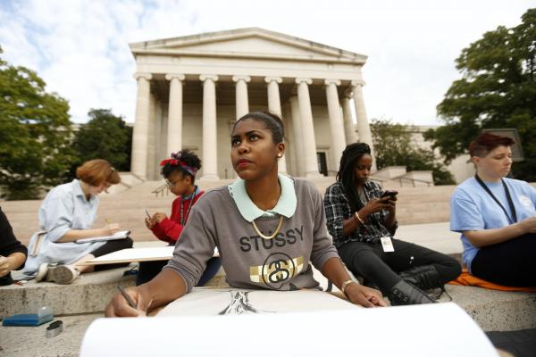 Tyree Brown (center) and her classmates from the Corcoran College of Art and Design hold class on the steps of the National Gallery of Art.