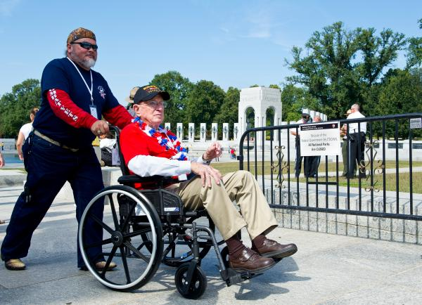 A World War II veteran visits the World War II Memorial on the National Mall on Tuesday.