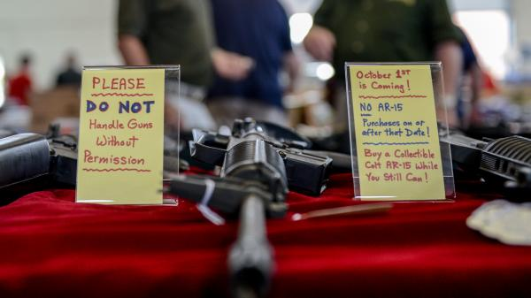 A sign warns would-be buyers at the Annapolis Gun Show in Annapolis, Md., in September of the state's pending gun control law. The new law, which took effect Tuesday, bans the purchase of many types of assault rifles.