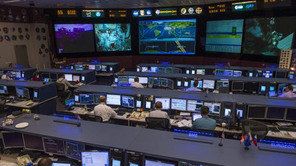 Staff at the International Space Station's flight control room in Houston will remain on duty during the government shutdown to keep operations running at the orbiting outpost.
