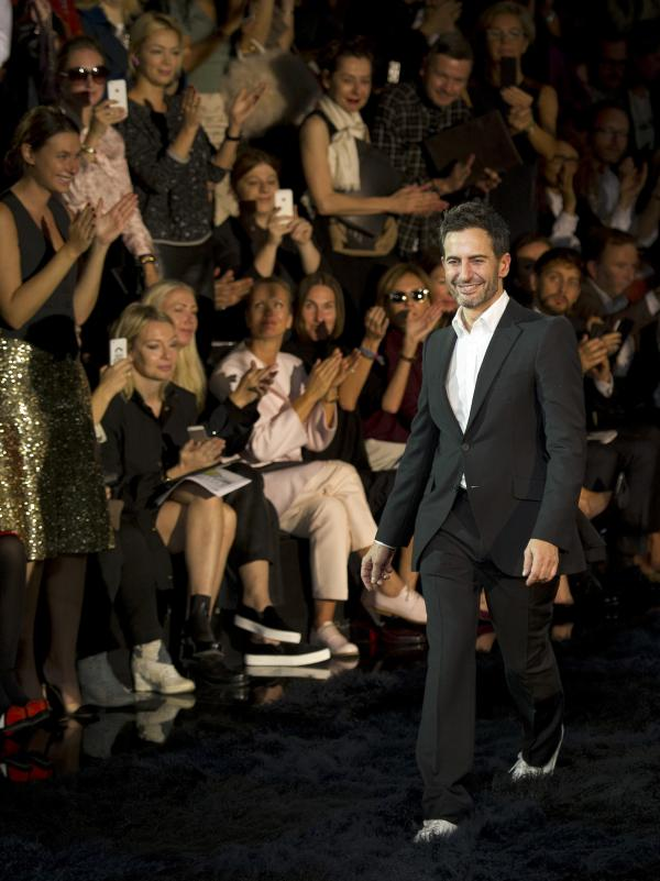 On Wednesday, fashion designer Marc Jacobs acknowledged applause following the presentation of the ready-to-wear Spring/Summer 2014 fashion collection he designed for Vuitton.