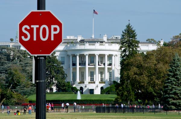 The White House is seen behind a stop sign in Washington, D.C, on Oct. 1.
