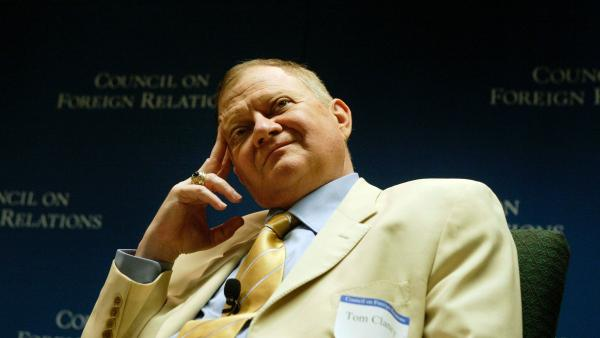 Author Tom Clancy, seen in 2004, was an insurance agent before publishing <em>The Hunt For Red October</em> in 1984.