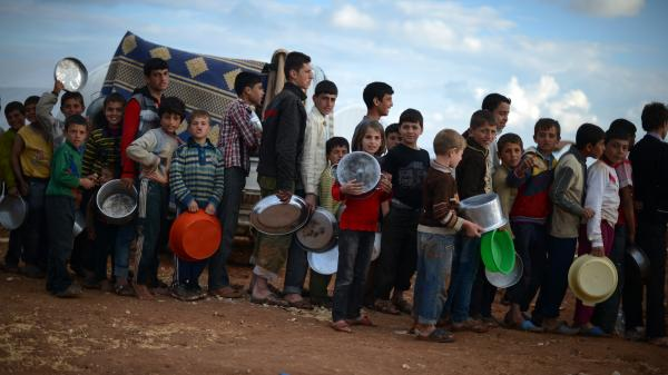 Syrian youths line up for food distribution in the Maiber al-Salam refugee camp in northern Syria, near the border with Turkey. The U.S. government has provided more than $1.5 billion in aid to Syrians since the uprising began in 2011.