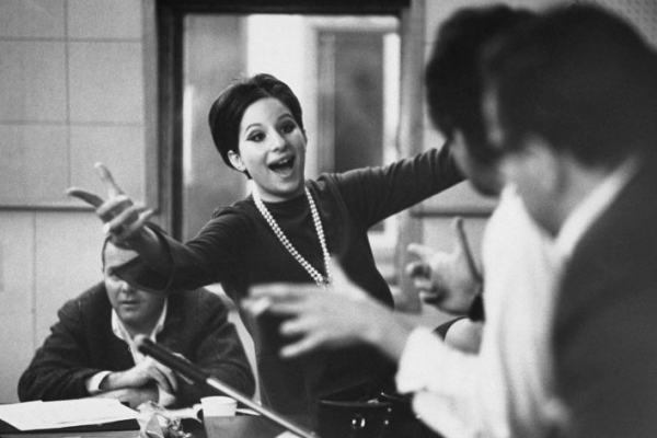 Barbra Streisand in a recording studio in 1966, listening to herself sing.