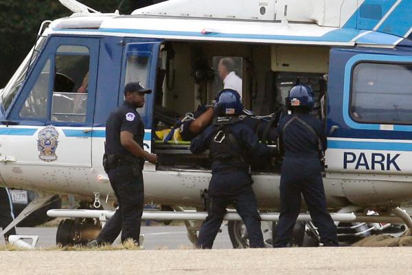A victim is loaded into a U.S. Park Police helicopter on the National Mall.