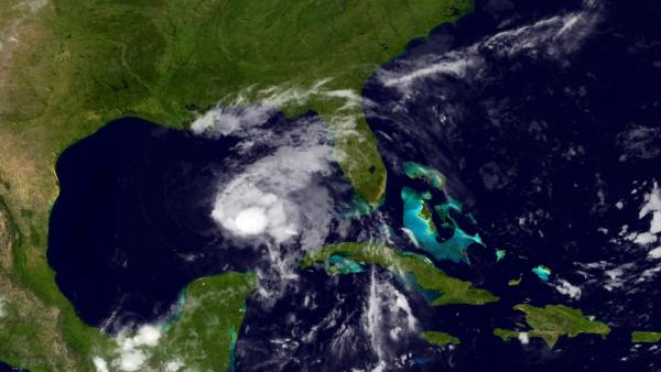 This image provided by NOAA shows Tropical Storm Karen taken late Thursday night Oct. 3, 2013. (NOAA via AP)