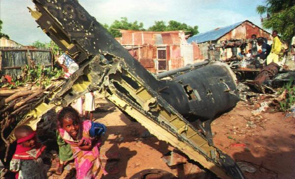 In December 1993, Somali children play around the wreckage of a U.S. helicopter in Mogadishu.