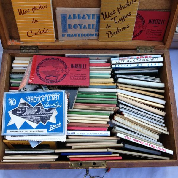 A box of souvenir photos at a Paris flea market