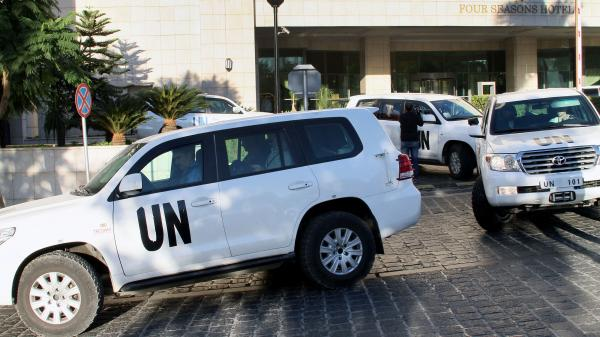 A convoy of chemical weapons disarmament experts depart the Four Seasons Hotel in Damascus, Syria, on Tuesday. A second team of experts will soon join mission to destroy Syria's chemical program.