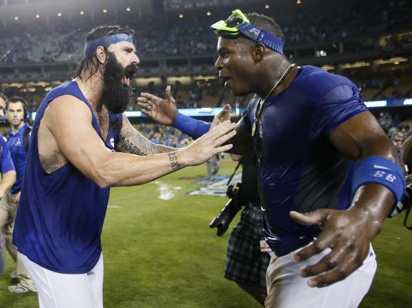 Yasiel Puig (right) celebrates with teammate Brian Wilson on Monday night after the Dodgers beat the Atlanta Braves 4-3 to advance to the National League Championship Series.