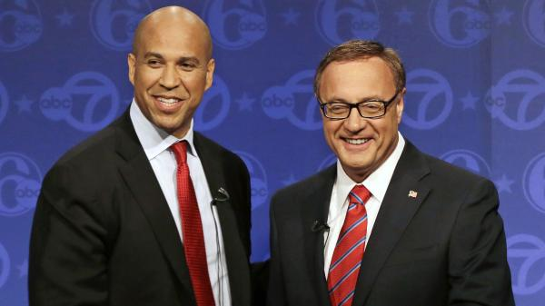 Democrat Cory Booker (left) and Republican Steve Lonegan stand together after their first debate in the race for U.S. Senate on Oct. 4 in Trenton, N.J.