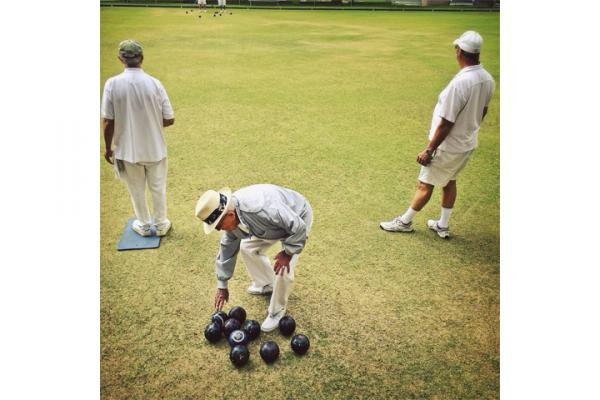 <strong>Pasadena, Calif.</strong> KPCC photographer Maya Sugarman passes the Pasadena Lawn Bowling Club every morning on her way to work. She drives 35 miles, parks at the nearby train stop and walks to the radio station. The bright green lawn and white outfits always catch her eye.