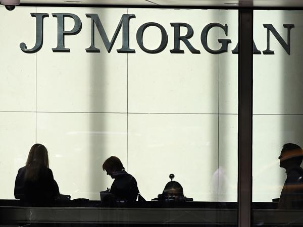 People pass a sign for JPMorgan Chase at its headquarters in Manhattan last year.