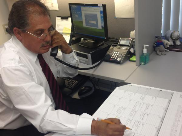 Edward Avalos, one of the first certified enrollment specialists in California, is a very busy man.